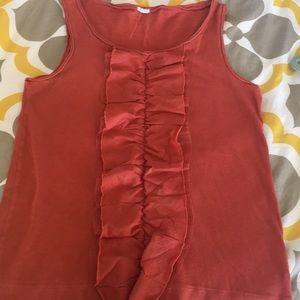 Sleeveless JCrew rust colored ruffle shirt.
